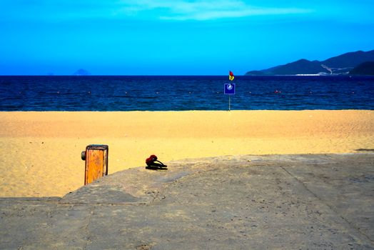 Flip flops waiting for their owner by the Nha Trang beach Vietnam.