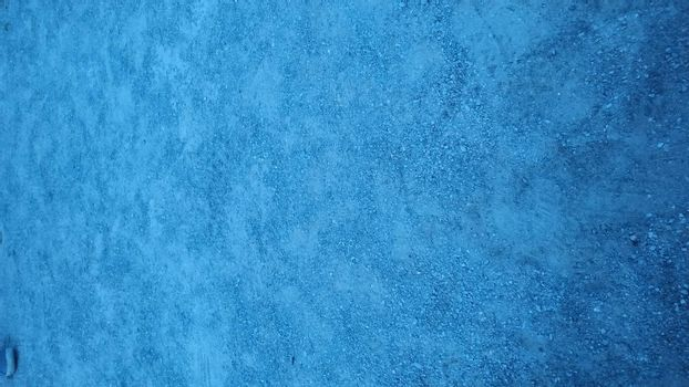 Plaster wall painted in light blue paint.