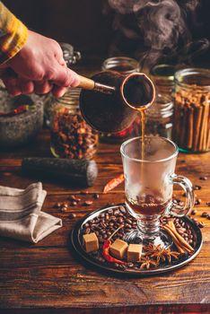Man Pour Coffee in Mug.