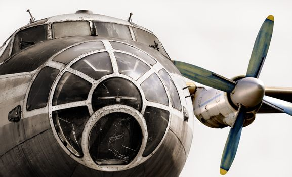 Old plane isolated. The nose of the aircraft, cockpit and aircraft engine. Old plane close up on a white background.