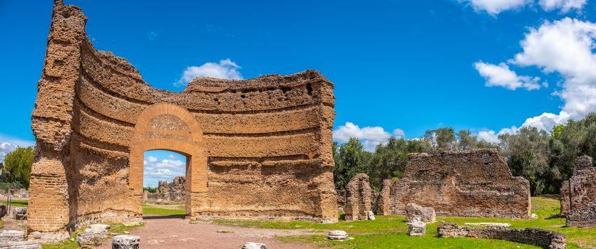 roman ruins panoramic Villa Adriana in Tivoli Rome - Lazio - Italy crumbled gate of the Ninfeo palace .