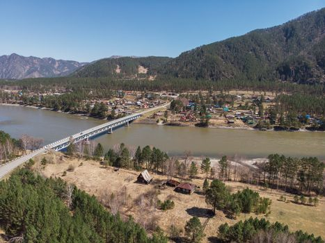 Aerial view of a road in summer landscape, in Altai mountains