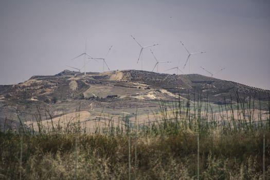 Wind turbines on the hill in the sicilian coast