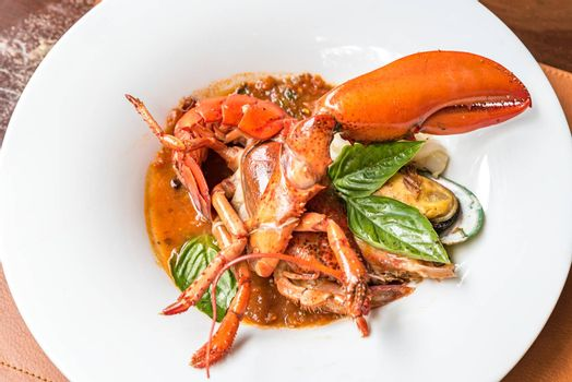 Pastis Grilled Halved Lobster Tails with mussel calamari