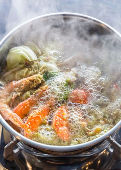 Seafood spicy hot pot crab prawn fish squid tumyum