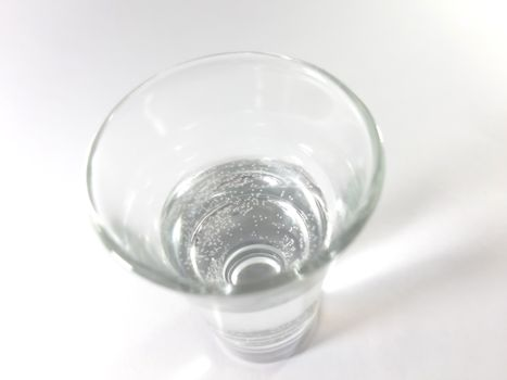 Drink in transparent glass. Liquid pure water in a glass. Photo isolated.