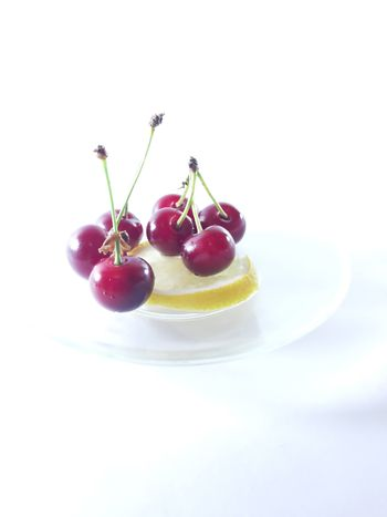 Photo cherry and lemon. Healthy food. Vegetarian red food. Berries and fruits. Berry for snack.