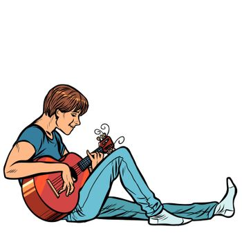 Young teenager man plays acoustic guitar