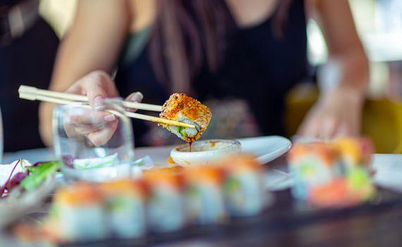 Enjoying sushi