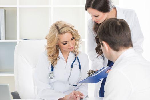 Doctors consulting patient