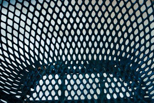 Black grille background.