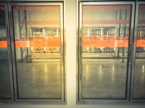 Row of empty commercial fridges at wholesale big-box store