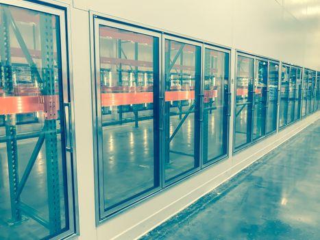 Vintage tone row of empty commercial fridges at wholesale big-box store