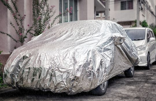 Weather Proof Car Cover Protects Vehicle from Rain