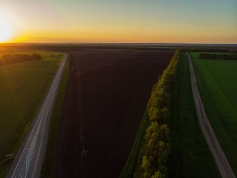 Top view of the road in summer evening. View from drone