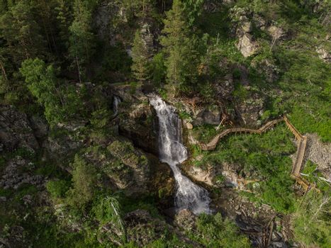 Aerial drone photo of view of waterfall in the Altai Mountains, Siberia, Russia