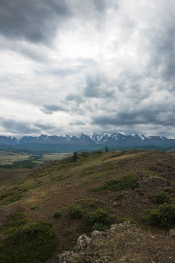 Summer in Kurai steppe and North-Chui ridge of Altai mountains, Russia. Cloud day.
