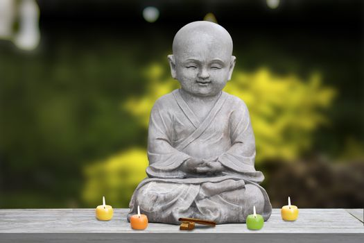 Buddha stone statue child background blur lit candles and incense