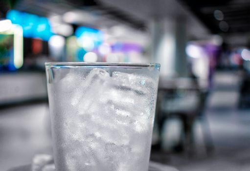 Frosted Chilled Glass Filled with Tubular Shaped Ice in a Bar