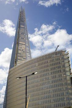 shard skyscraper towering over an office block at london bridge