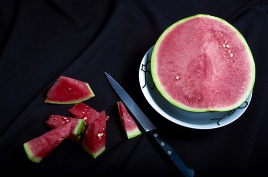 Watermelon chopped black background