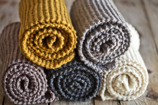 Five knitted wooden scarves