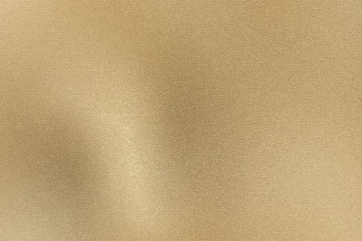 Glowing light brown brushed metal wall, abstract texture background