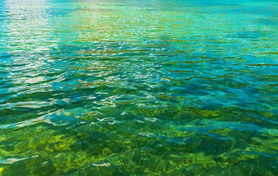 Crystal Clear Lake Water Closeup Photo. Nature Background Photo