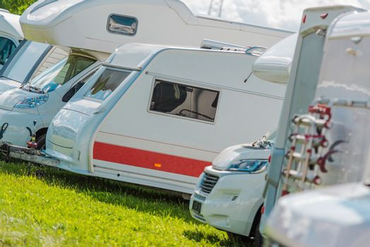 RV Campers Storage Parking with Many Recreational Vehicles in Row.