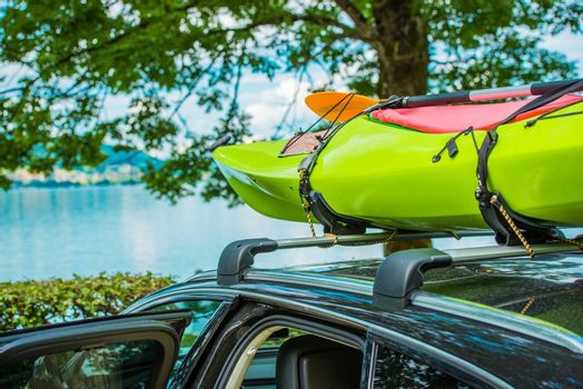 Vacation on the Water. Kayak on the Car Roof During Summer Vacation Trip.