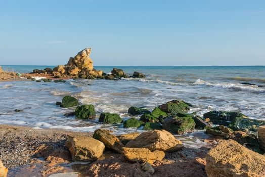A scattering of large stones by the sea