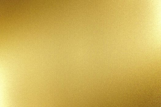 Light shining on gold metal board, abstract texture background