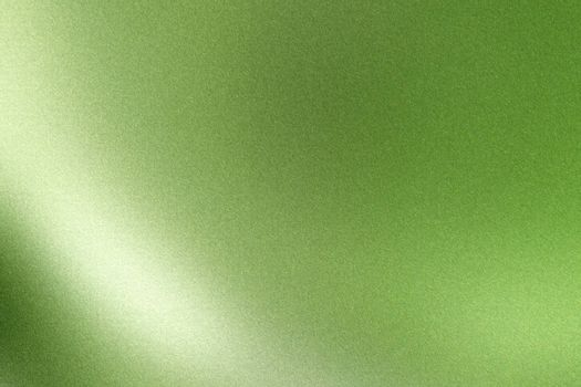 Light shining on green wave metallic wall, abstract texture background