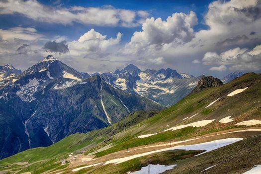 Panorama of mountains scene with dramatic blue sky in national park of Dombay