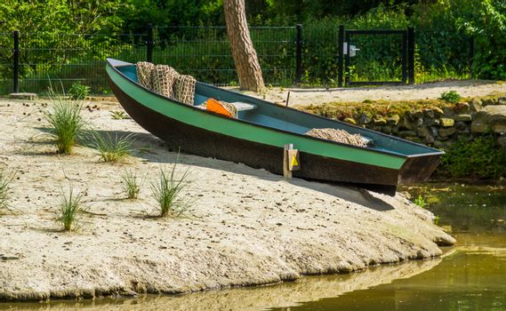 modern fishers boat on the embankment, Fishing sport equipment, recreational sports