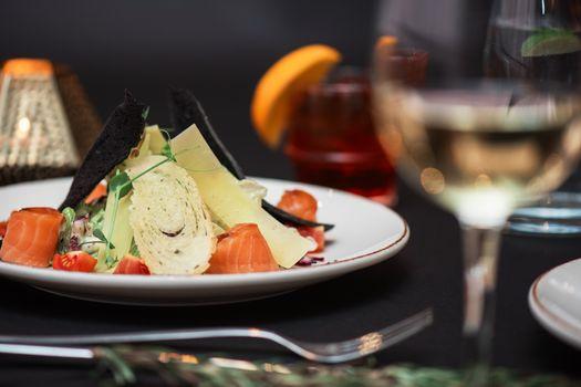 Caesar salad with salmon fish. Tasty restaurant dish