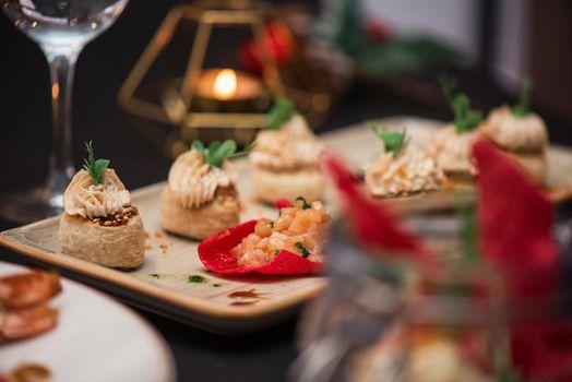 Kegs with salmon fish and cream sauce. Tasty restaurant dish