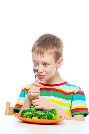 portrait of a boy with a plate of broccoli, shooting on a white background is isolated