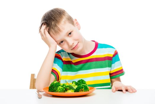 Child and a plate of broccoli, concept photo food and children