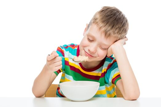 healthy food - oatmeal for breakfast, a boy with a plate on a white background