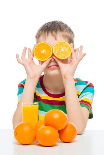 humorous photo of a boy with oranges and fresh juice on a white