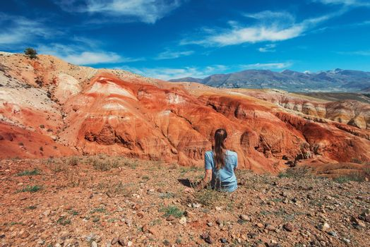 Woman in valley of Mars landscapes in the Altai Mountains, Kyzyl Chin, Siberia, Russia