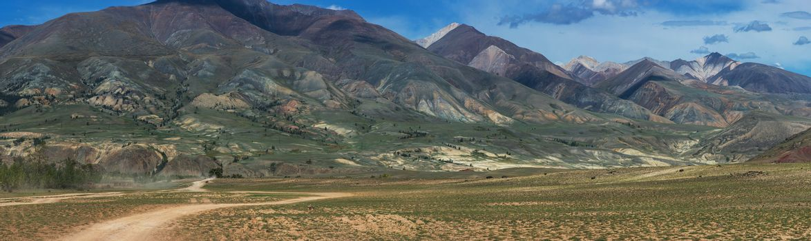 Panoramic picture of colored mountains near Mongolian Altai mountains, Russia.
