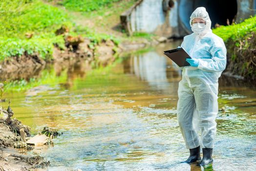 an experienced scientist ecologist, biologist conducting research environment pollution