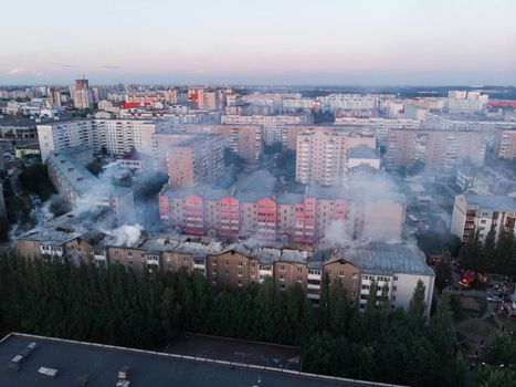 Aerial shots of a fire destroys a residential building in the city quarter