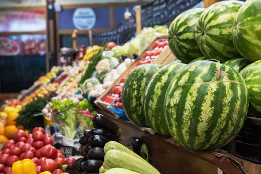 Ripe watermelons in farmer market: fresh organic healthy watermelons at grocery store.
