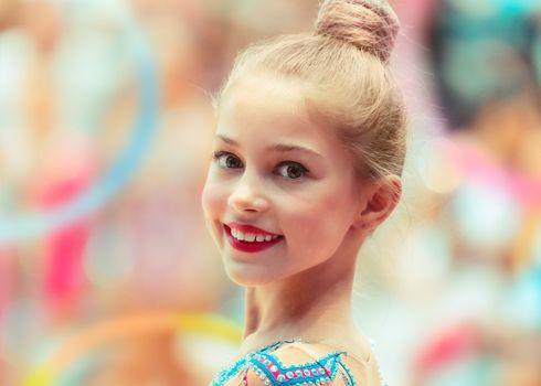 Portrait of a happy gymnast girl