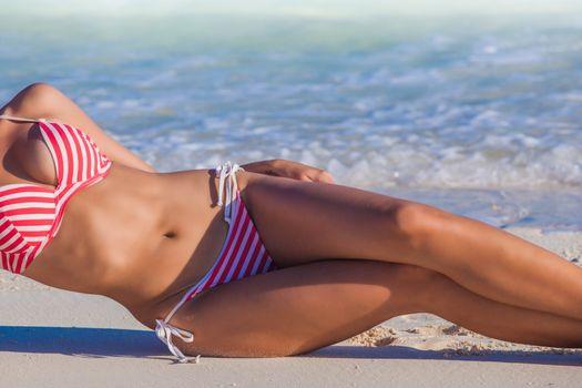 Woman laying on beach