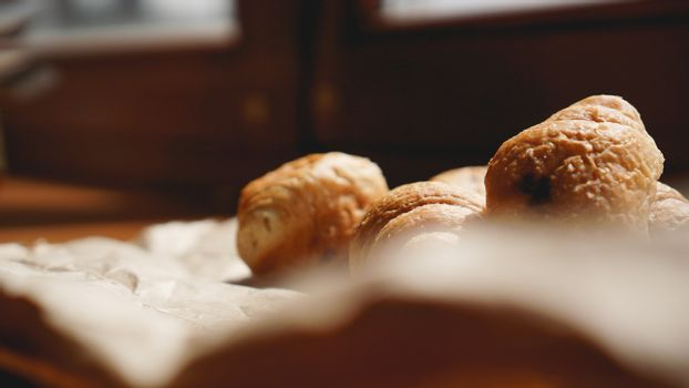 French breakfast with croissant, kraft crockery on kraft paper