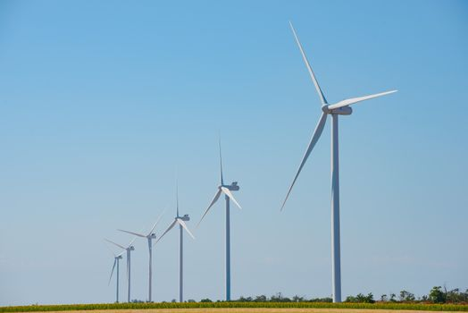 Wind Generator Turbines on the Blue Sky Bacground. Green Renewable Energy Concept.